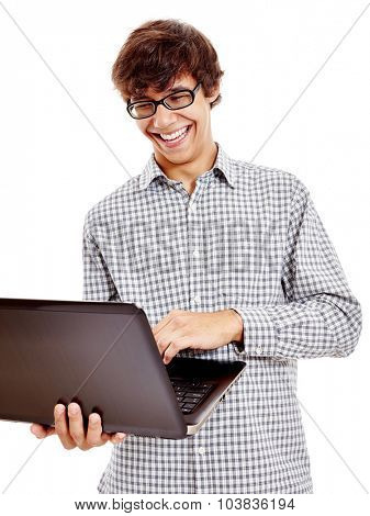Young hispanic man wearing blue checkered shirt and black glasses reading something funny from his laptop and loudly laughing isolated on white background - humor and communication concept