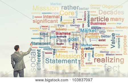 Rear view of businessman writing leadership skill concept