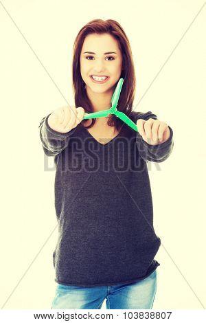Caucasian happy woman holding small windmill