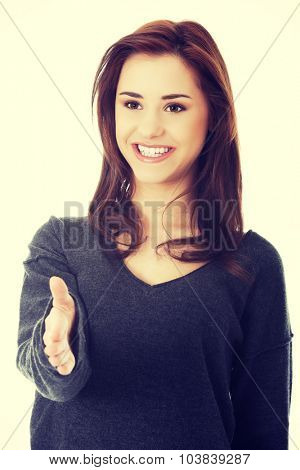 Smiling woman with an open hand ready for handshake
