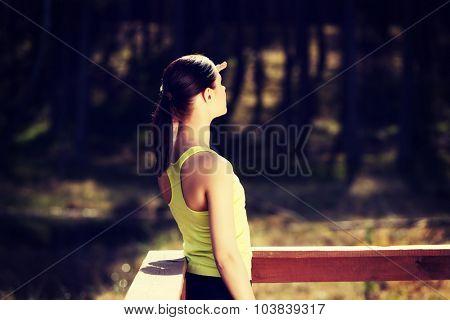 Beautiful woman relaxing after running