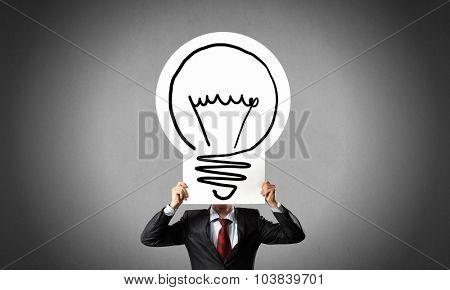 Unrecognizable businessman holding light bulb paper concept