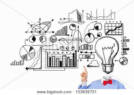 Unrecognizable businessman with business sketches instead of head on white background