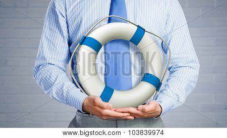 Close up of businessman with life buoy in hands