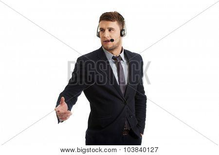 Handsome call center man talking through phone.