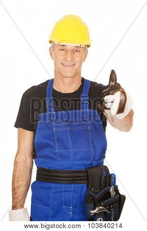 Mature repairman showing thumbs up.
