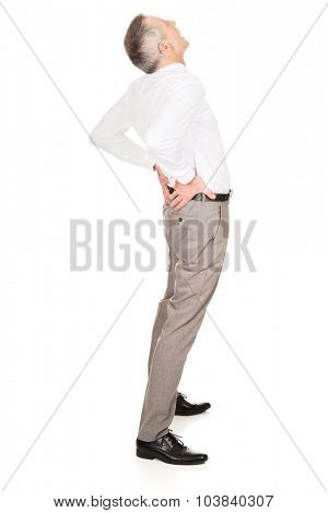 Full length businessman suffering from back pain.