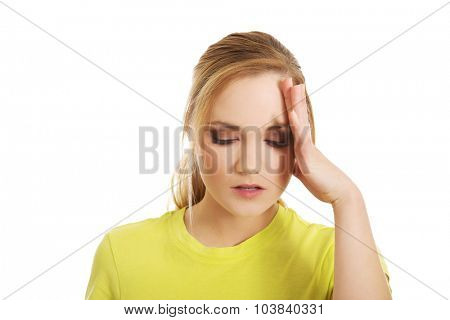 Young casual student woman suffering from headache.