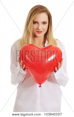 Young beautiful woman with heart shaped balloon.
