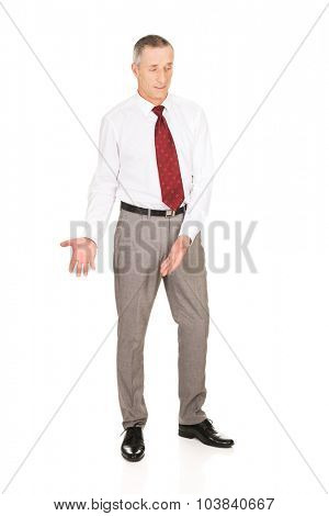Full length businessman showing copyspace on the floor