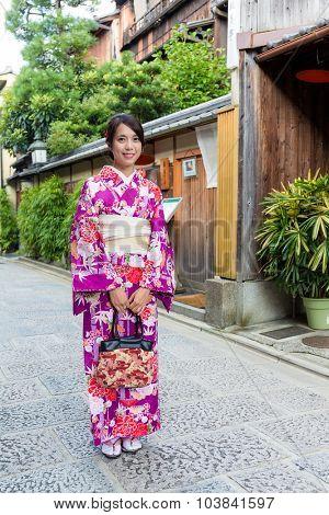 Woman with kimono dressing at street