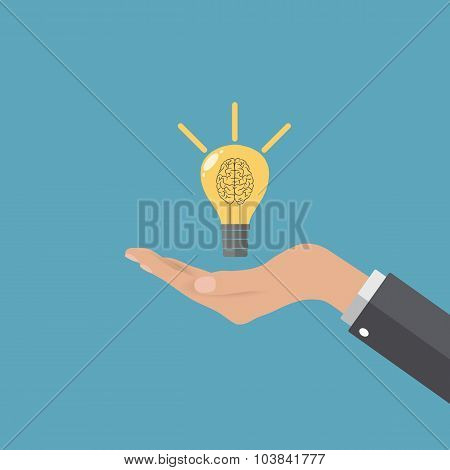 Light bulb at buisness man hand