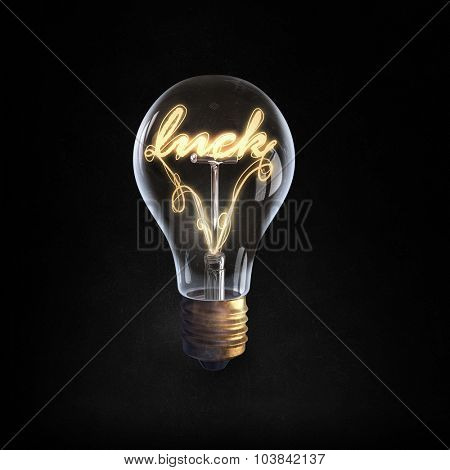 Glowing glass light bulb with word luck inside