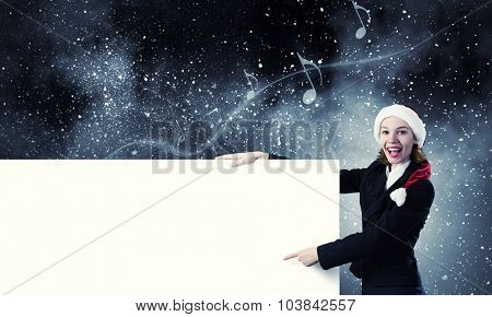 Santa woman pointing with finger at blank banner. Place for your text