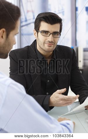 Closeup portrait of elegant young businessman at business meeting.
