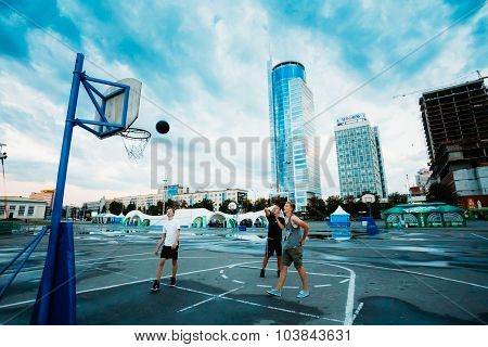 Young people play street basketball in the center of Minsk in th