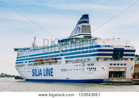 Modern ferry boat Silja Line at pier awaiting loading cargo