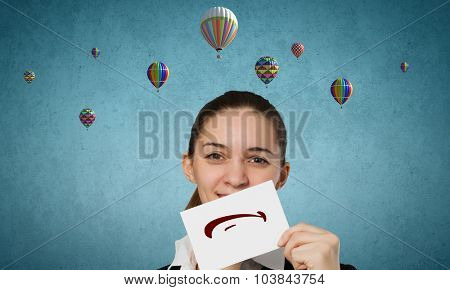 Young businesswoman holding paper with unhappy sad smiley