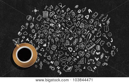 Top view of coffee cup and sketches on dark background