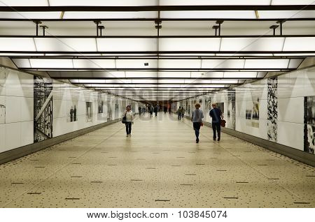 Brussels, Belgium - May 12, 2015: Travellers In The Futuristic Corridor Of Brussels Central Train St
