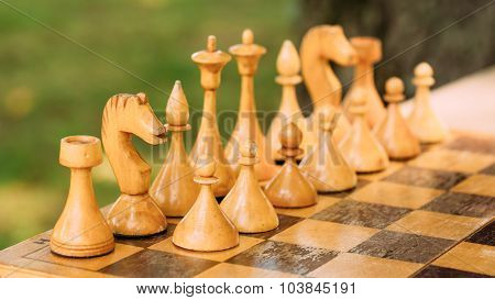 Old Vintage Chess Standing On Chessboard