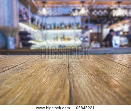 Table top with Blurred Bar Counter with Bartender