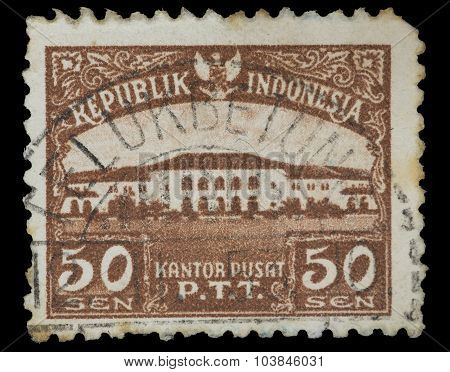 Postage Stamp Printed In Indonesia Shows The P.t.t. Headquarters