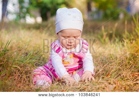 Cute Baby In Autumn Leaves.