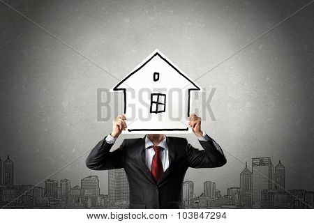 Unrecognizable businessman holding paper covering his face