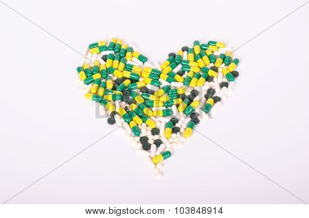 Pills, dietary supplements, drugs forming a heart