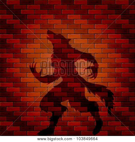 Shadow Of Werewolf On A Brick Wall