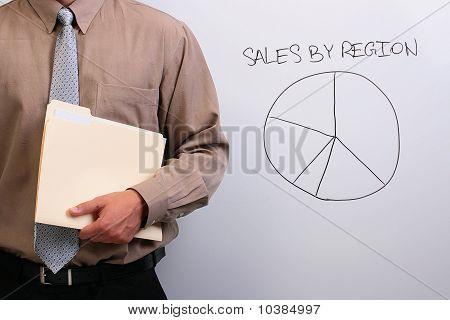 Man Holding A Manila Folder