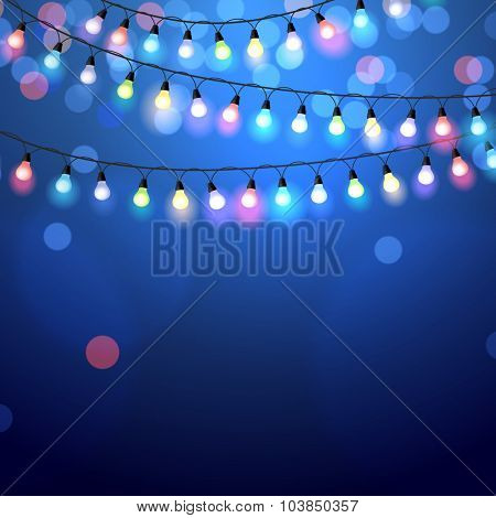 glowing Christmas Lights on blue background