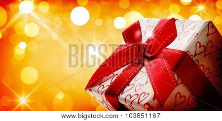 Decorative Gift Box With Golden Bokeh Background Close Up