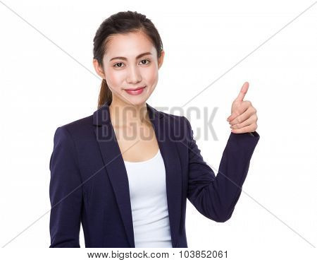 Young businesswoman with thumb up gesture