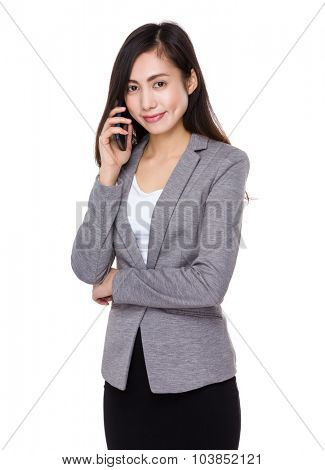Young businesswoman talk to mobile phone