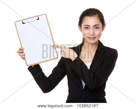 Asian businesswoman finger point to blank page of clipboard
