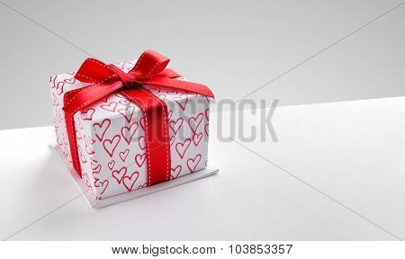 Gift Box With Hearts Printed With Diagonal Grey Background
