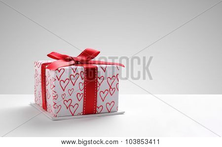 Gift Box With Hearts Printed With Grey Background Front
