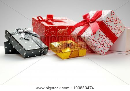 Group Gift Boxes With Bow With Grey Background Front