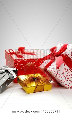 Group Gift Boxes With Bow With Grey Background Vertical Composition