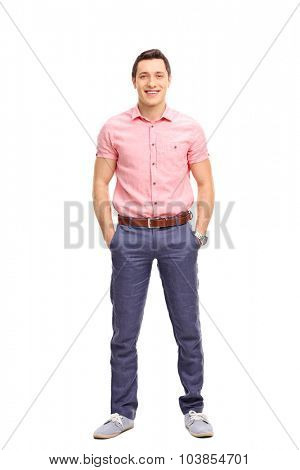 Full length portrait of a cheerful young man in casual outfit standing and looking at the camera isolated on white background