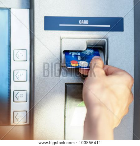 Female hand - close up - cash withdrawals at ATMs
