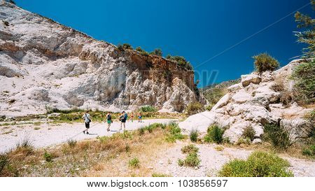 People walk on the tourist route by the Rio Chillar River near N