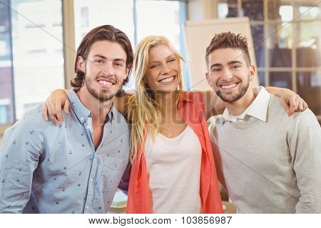 Portrait of happy business people at meeting room in creative office