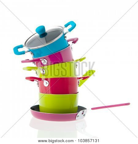 Stacked pots for cooking isolated over white background