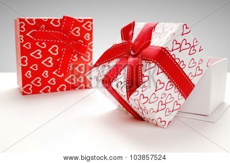 Two Gift Boxes With Hearts Printed With Grey Background