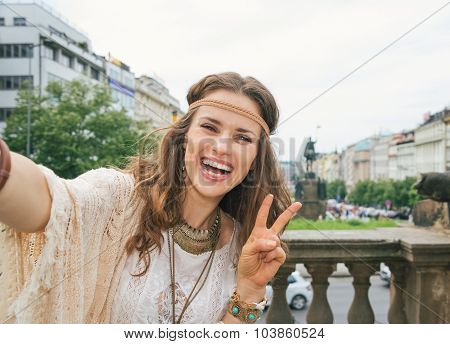 Hippy Woman Tourist Making Selfie In Prague And Showing Victory