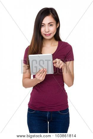 Asian Young woman use of the tablet pc
