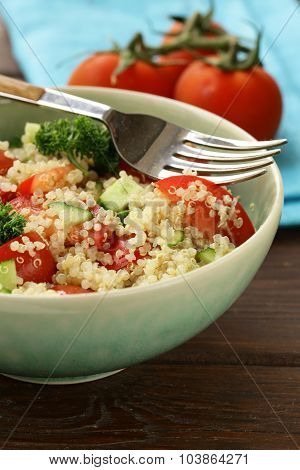 Quinoa salad with cucumber and tomato in a bowl